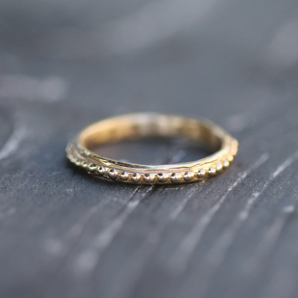 2.5mm band set in 14k yellow gold