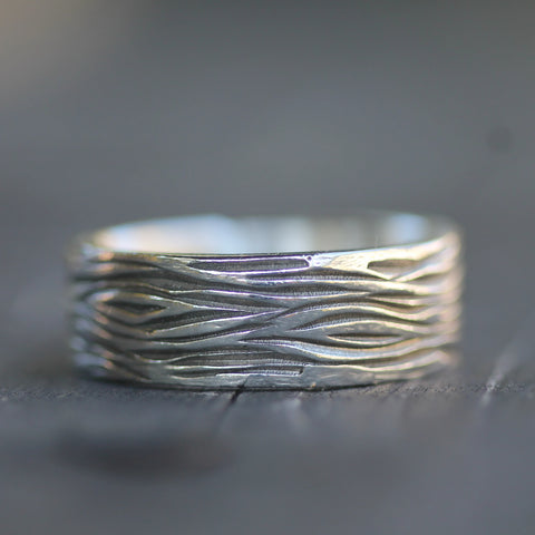 Hand carved wedding band with tree inspired texture
