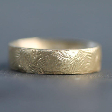 Hand carved sand inspired gold wedding band