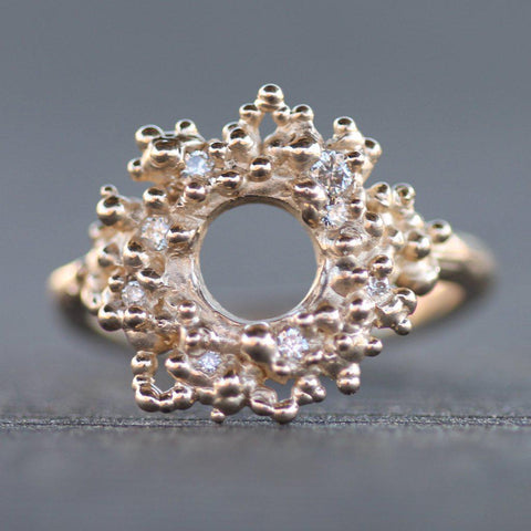 Hand carved gold reef sun ring with scattered diamonds throughout