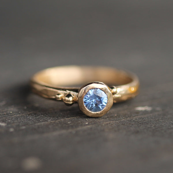 Unique sapphire engagement ring in 14k yellow gold