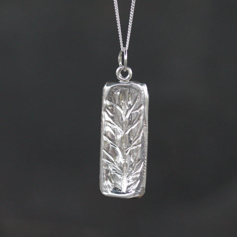 Hand carved tree inspired pendant in sterling silver