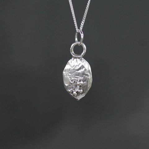 Sterling silver pendant with white topaz