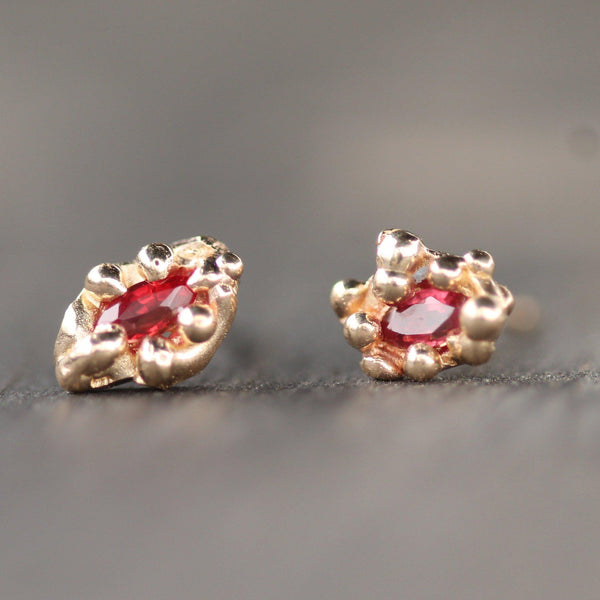 Little mermaid studs in 10k yellow gold with rubies