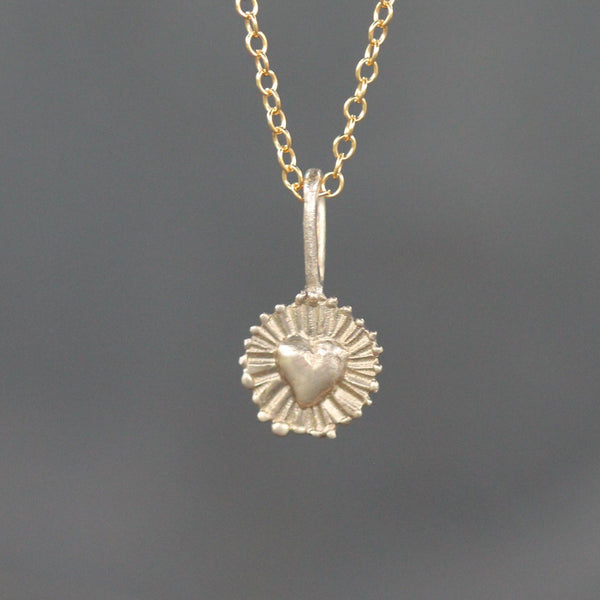 Hand carved heart pendant in yellow bronze