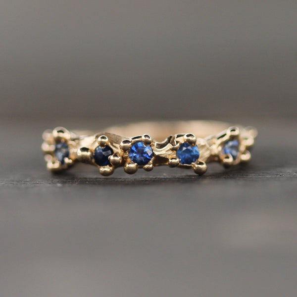 Blue sapphires with golden bubbles