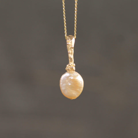 Freshwater cultured pearl on 10k yellow gold bail