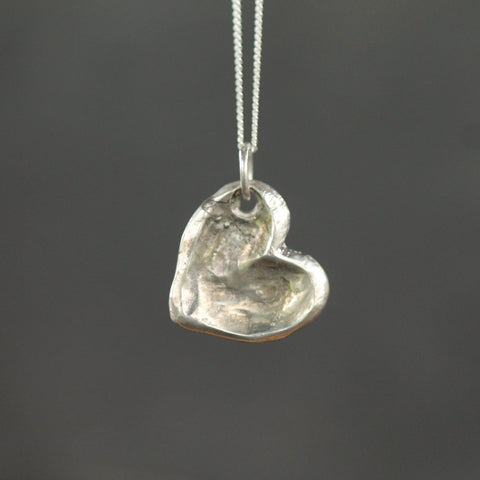 Heart pebble pendant pictured in sterling silver