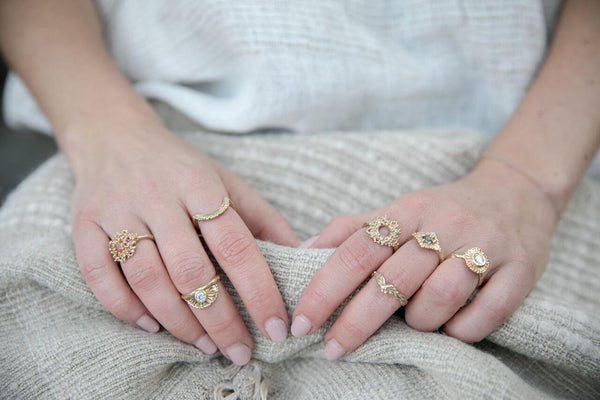 Hand carved rings made in 14k yellow gold pictures on hands