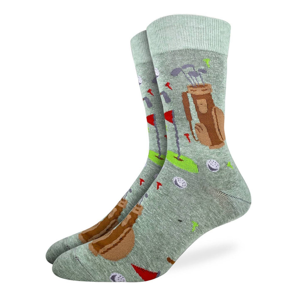 FORE! These socks are sure to have you shooting straight and putting right. Express your love of the technical sport with these socks. They are a light sage green colour and feature golf balls, golf bags, putting holes and flags. 85% Cotton, 10% Polyester, 5% Spandex
