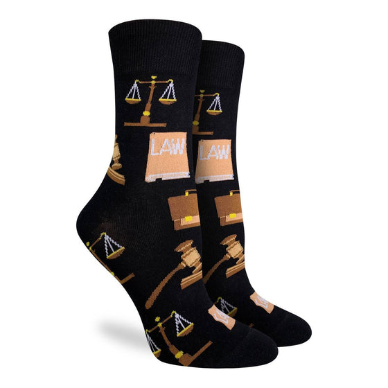Get ready to serve up sweet justice wearing these black socks, adorned with courtroom icons such as the scales of justice, a briefcase, a law book and a gavel. 85% Cotton, 10% Polyester, 5% Spandex