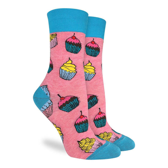 These delightful socks feature several cupcakes of different styles. They are light pink with blue toes, heels and cuffs. Perfect for the sweet-toothed confectioner in us all! 85% Cotton, 10% Polyester, 5% Spandex