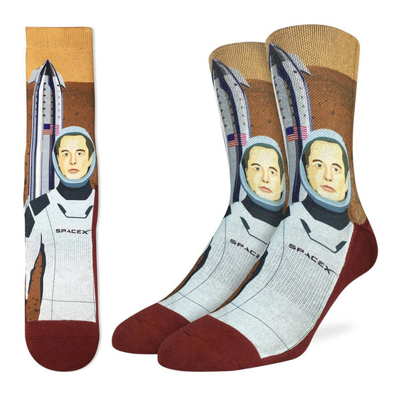 These socks are ready top be shipped off to Mars. With a design featuring Elon musk in his SpaceX suit and a rocket ship adorned with the American flag.  48% Polyester, 45% Cotton, 5% Elastic, 2% Spandex