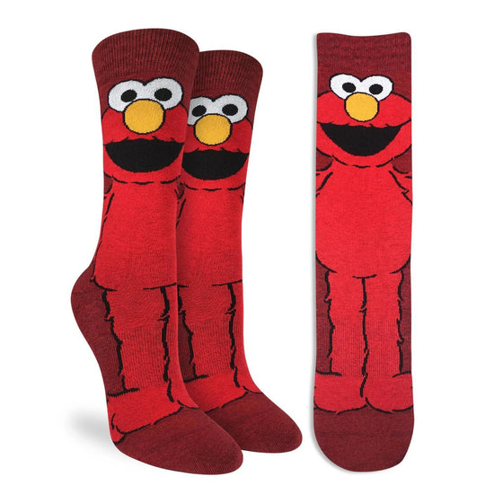 "These red active fit socks feature a full body design of Elmo! This cheeky fellow from Sesame street has his mouth open as though saying ""Hi"" Reminisce over the fantastic puppetted series with these playful socks. 48% Polyester, 45% Cotton, 5% Elastic, 2% Spandex"