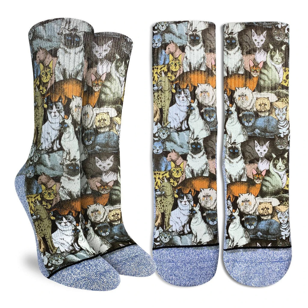 This pair of active fit socks features a plethora of spiffy looking felines.  The heel through to the toe is a light blue and white knit pattern. 48% Polyester, 45% Cotton, 5% Elastic, 2% Spandex
