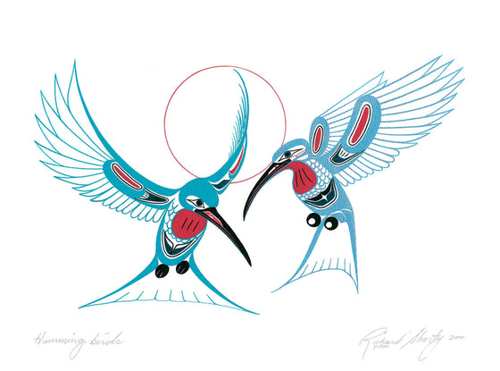 Two bright blue hummingbirds hover on a white background. They have black wings and feet. Blue u-shapes create individual feathers on their bodies and wings. Their throats are red, and they each have a red spot on their wings. A thin red circle halos the background behind the birds. This Canadian Indigenous print was painted by Richard Shorty. He is from the Yukon's Northern Tuchone Tribe.
