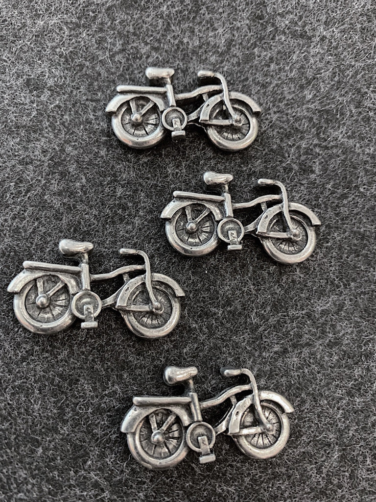 This set of magnets features four bicycles with top wheel covers and a cargo racks over the rear wheels.