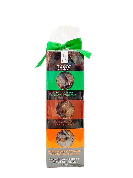 This towering box contains three 90 gram bags of cookies flavoured with dark chocolate, mint chocolate and orange chocolate, respectively. A colourful stripe helps you identify which bag of cookies has which flavour. This box is wrapped with clear cellophane and topped with a bow (how sweet)!