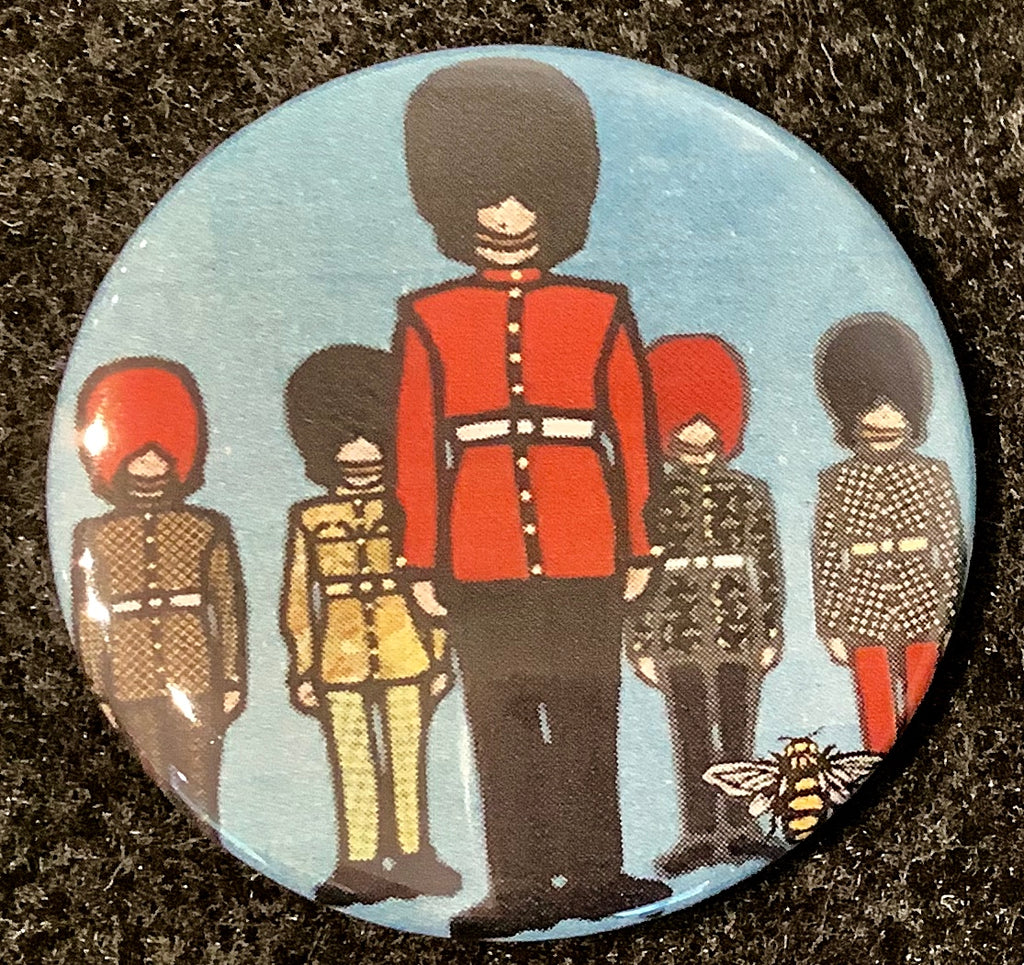 This magnet features an art print of five soldiers in ceremonial outfits. One soldier stands in the foreground, and the remaining four in the background. Each solider is wearing long pants, a belted jacket, and a tall beefeater hat. Each jacket has a unique,  colourful print. At the bottom right of the picture is the artists mark—a small picture of a bee.