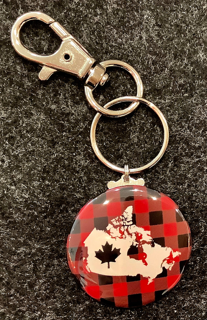 Plaid round tab featuring Canada (country) and a maple leaf attached to a ring and a clasp