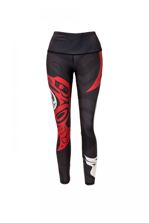 These black, red and white leggings are decorated with a Haida eagle and raven, juxtaposed as ying and yang, though they are hard to see in this photo. The front of a red raven can be seen here on the right leg.