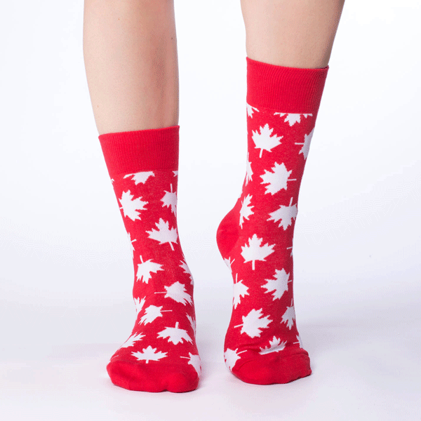 These fun socks feature white maple leaves scattered over a base of bright red. Spandex added to the 85% cotton blend gives the socks the perfect amount of stretch to hug your feet.