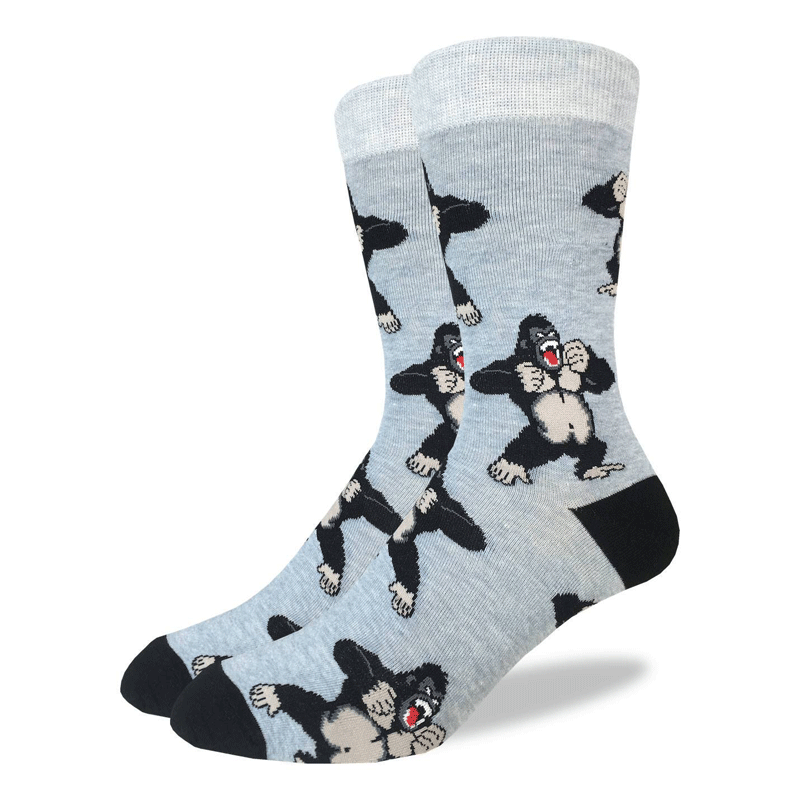 These fun socks feature images of cartoon gorillas yelling and beating their chests with their fists. The background of these socks is a light grey, while the heel and toe are black and the rim a lighter grey. Spandex added to the 85% cotton blend gives the socks the perfect amount of stretch to hug your feet.