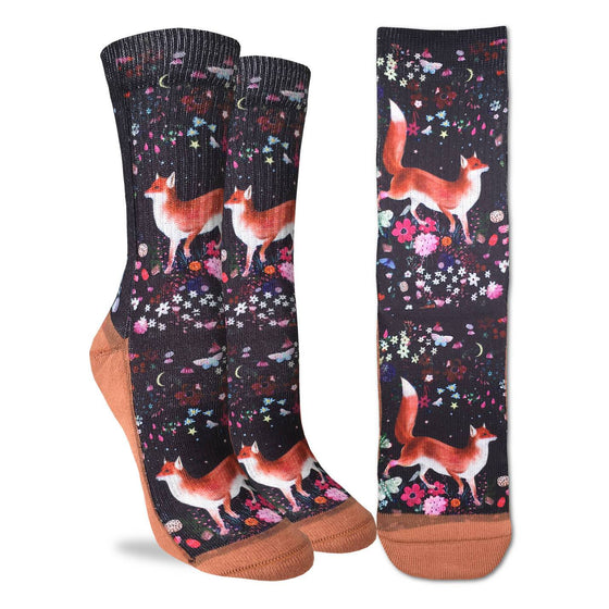 These fun socks feature beautiful red foxes walking among a field of brightly coloured flowers and butterflies. Behind the foxes and flowers is a black background, and the sole, toe, heel, and rim of the sock are a light brown. The active fit socks sport elastic arch bands to contour to your feet and provide support.
