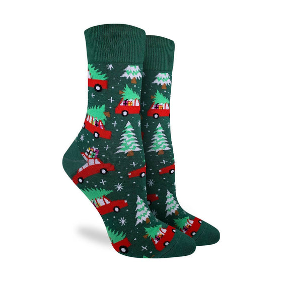These fun socks feature images of a snowy pine tree, and a red car driving with a pine tree on top. The images are on a base appropriately coloured a deep pine green. Spandex added to the 85% cotton blend gives the socks the perfect amount of stretch to hug your feet.