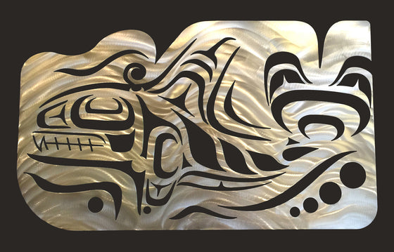 A Coastal Salish wall sculpture on a black background. Crescents, u-shapes and trigons carved out of a brushed metal sheet create the form of an imposing Orca whale with a tall dorsal fin and strong tail. The top edge of the metal sheet has also been carved to create the impression of water moving in response to the powerful motion of the whale.