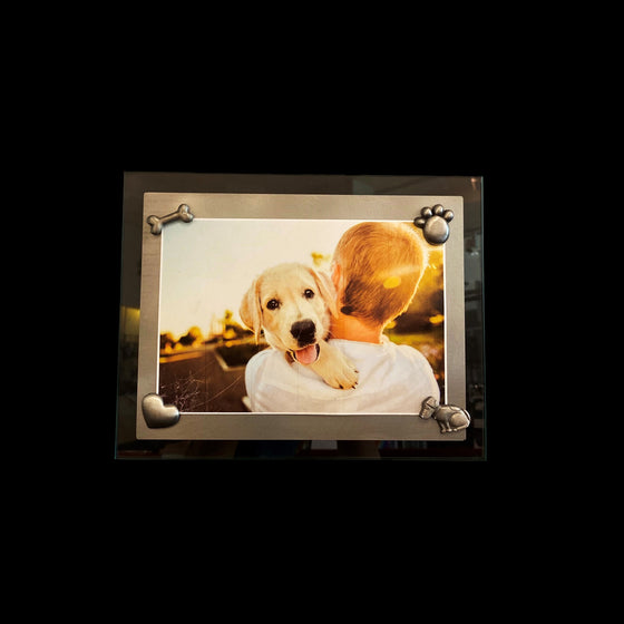 This frame consists of a rectangular sheet of brushed steel on a larger rectangle of glass. A photo of a boy and a golden retriever is held on with the dog magnet set.