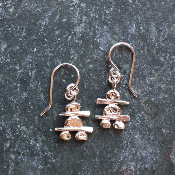 Two sterling silver Inukshuk hook earrings. Each handmade Inukshuk is unique and shaped slightly different than each other.