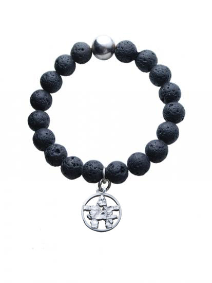 A bracelet made up of stringed lava beads, with one silver bead opposite to the inukshuk charm. The charm is a special pewter-silver alloy and is in the shape of an encircled inukshuk.