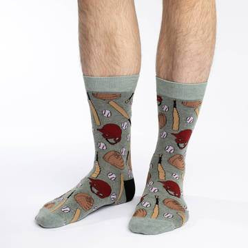 These fun socks feature baseballs, helmets, bats, and gloves on a background of grey, with a lighter grey toe and rim, and black heel. Spandex added to the 85% cotton blend gives the socks the perfect amount of stretch to hug your feet.