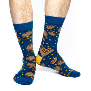 These fun socks feature hot dogs, dressed with mustard, and hamburgers, with lettuce, tomato, and cheese, on a background of blue with green and yellow spots scattered around, and a yellow heel. Spandex added to the 85% cotton blend gives the socks the perfect amount of stretch to hug your feet.