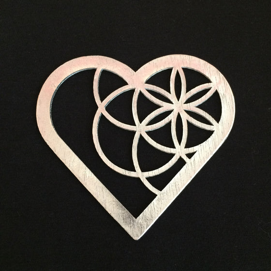 A heart outline with several circles forming a star pattern that sits in the top left portion of the heart.