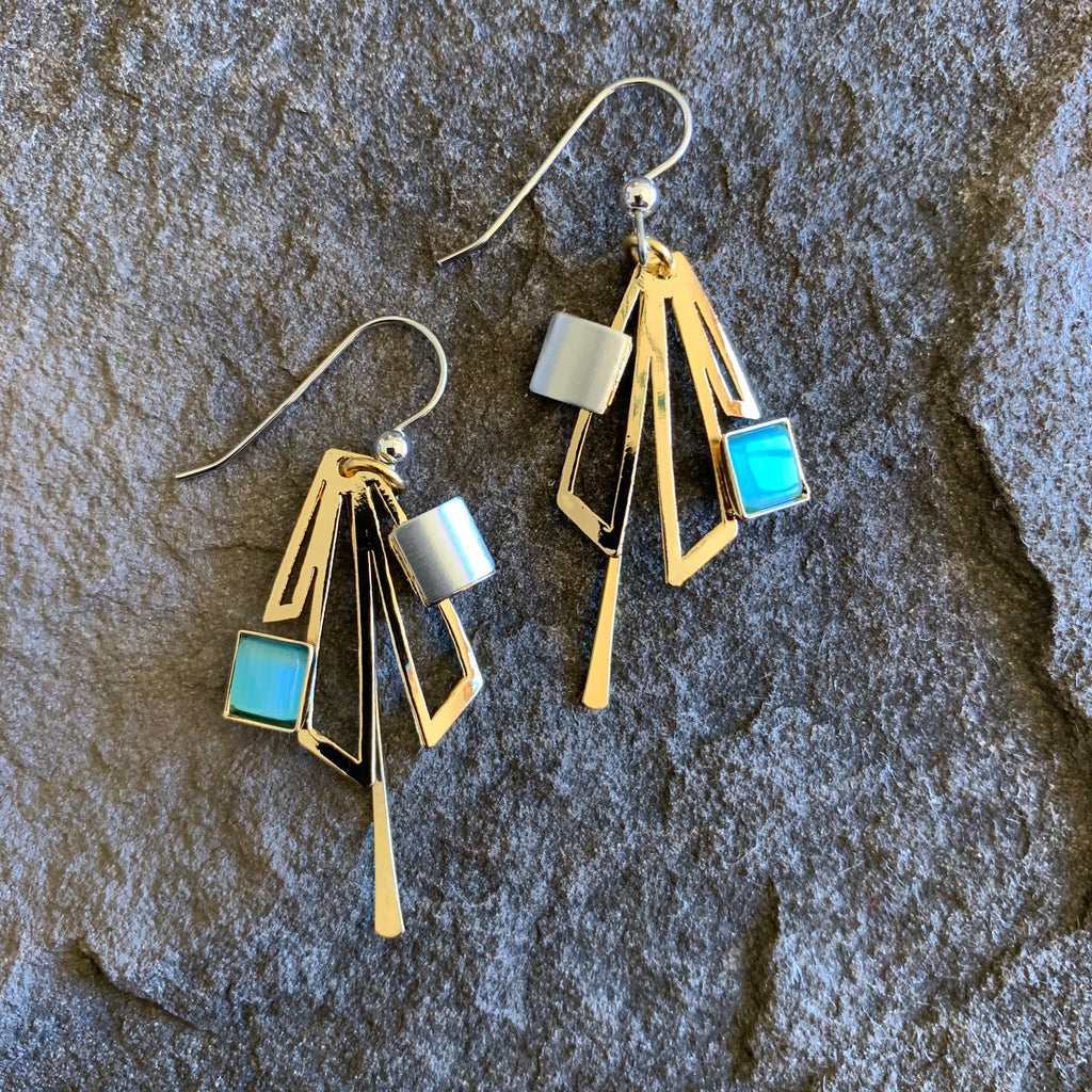 Bright gold coloured earrings with turquoise glass pieces offset to the side. The golden metallic part is shaped like offset rectangles and a post down the middle.