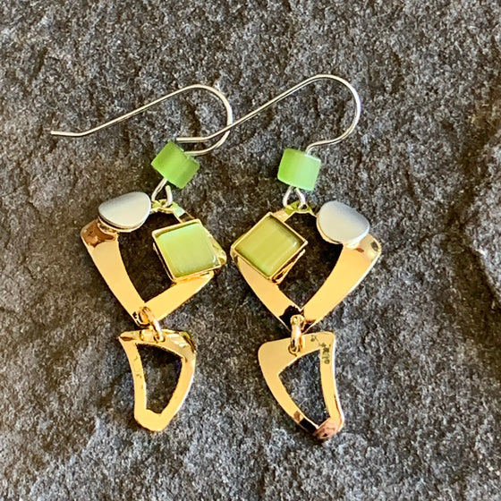 Two-piece bright gold earrings with two rounded squares on top of one another ,decorated with olive coloured glass pieces and pearlesque circles