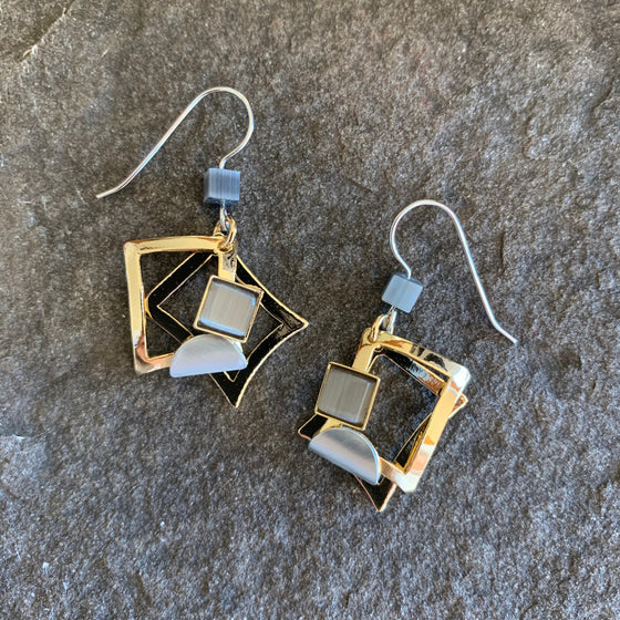 A bright gold finish on these squared off earrings, The design is of two square shapes, offset from one another by about 45 degrees and with a piece of grey glass in  the middle.