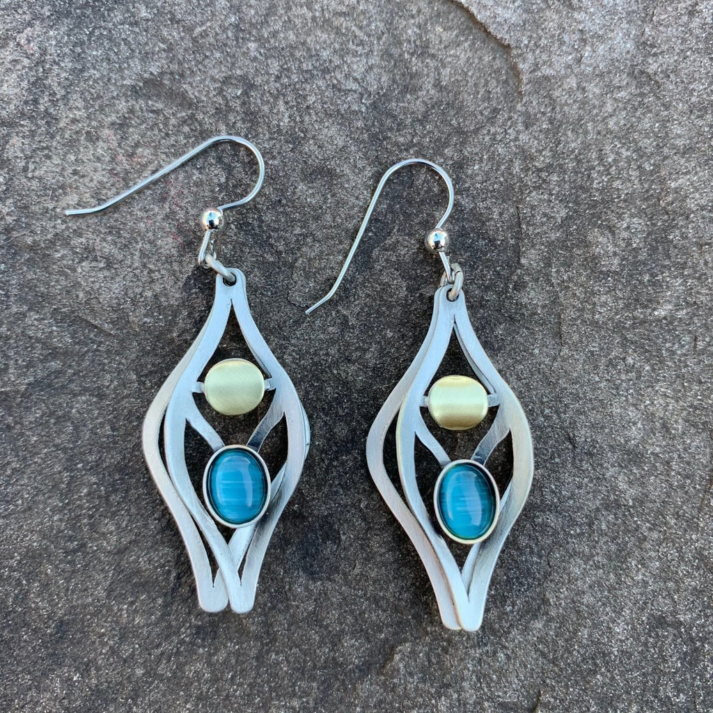 Beautiful shield shaped earrings, the shape resembles that of a bird's head from head on. these earrings are in a brushed silver metal colour, surrounding an aqua coloured center glass piece.