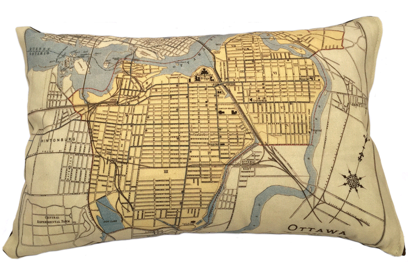 This large pillow features a vintage map of Ottawa. The map is printed in black on a yellow and tan background. The rivers and canals are coloured pale blue. This map highlights the areas now known as Centertown and Downtown, and includes landmarks such as Parliament, the experimental farm, and Dow's lake.