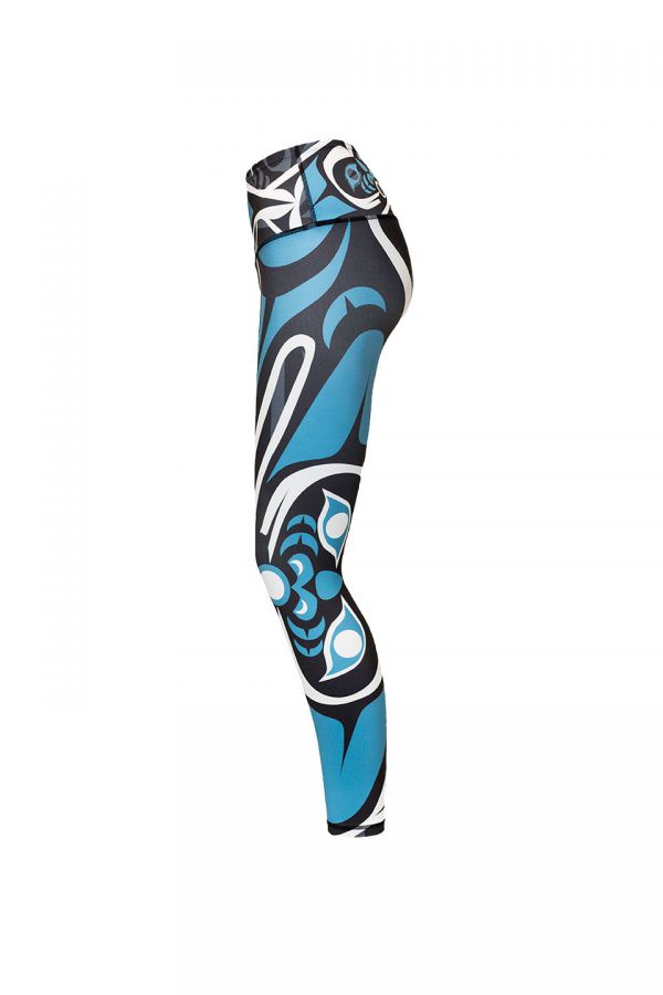 The wolf leggings viewed from the left. This angle provides a clear view of the large teal and white moon on the left leg.