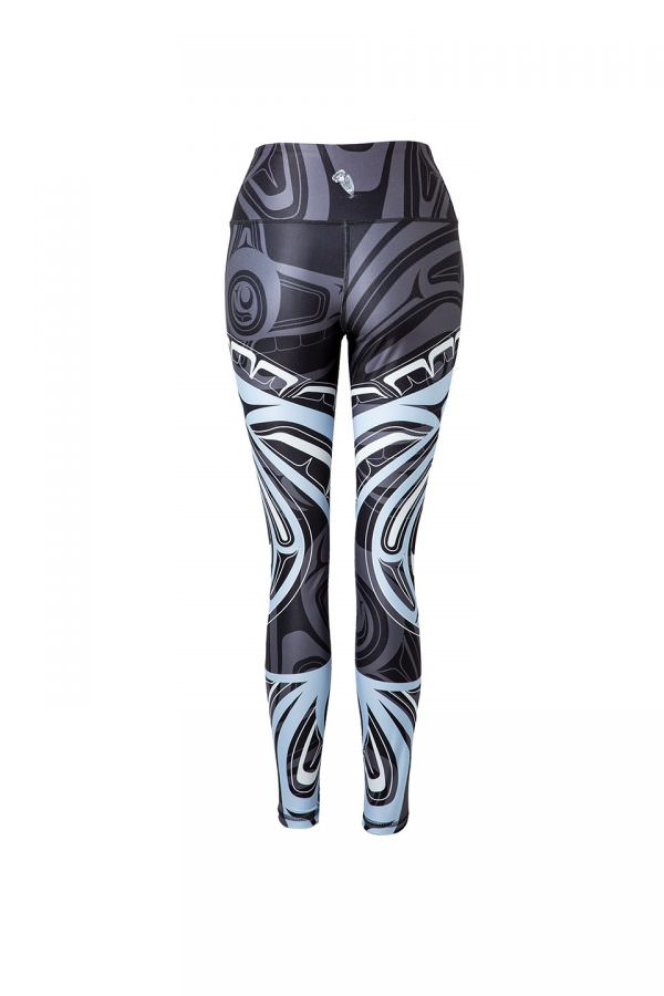 The wolf moon leggings viewed from behind, providing a partial view of the blue and white moon motif. A grey wolf's head with bared teeth can be seen across the left hip.