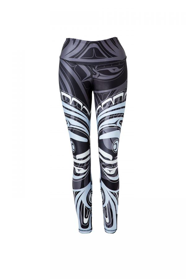 These black, grey, blue and white leggings are decorated with a Haida moon and wolf. Each leg has one large complex moon figure printed on it in blue and white. In the background is a wolf design printed subtly in grey on black.