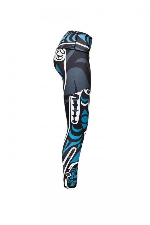 The wolf leggings viewed from the right. This angle displays the wolf. Its outline is in white and its fur and eyes are teal. It is baring its teeth. At the base of the right leg is another small teal moon.