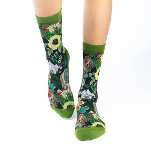 These adorable socks feature dogs, such as a pug, shitzu, and shiba inu, in disguise as flowers. Leaves wind among the flower dogs on a black background. The sole, toe, heel, and rim are a deep green. The active fit socks sport elastic arch bands to contour to your feet and provide support.