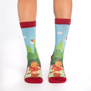 These fun socks feature a beaver dressed as a lumberjack red and black plaid shirt with an axe over its shoulder. The beaver stands waving on a tree stump with trees and a blue sky in the background. The active fit socks sport elastic arch bands to contour to your feet and provide support.