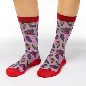 These cute socks will decorate your feet with several cute and colorful tropical birds in a neo-traditional art style. The sock background is a soft pink while the cuff and heel through to the toe is a vibrant scarlet. 48% Polyester, 45% Cotton, 5% Elastic, 2% Spandex