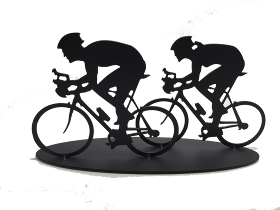 This metal sculpture shows the matte black silhouette a male and female cyclist riding together. The female cyclist is to the right and slightly behind the male. Both are hunched forward over their handle bars. The bikes are slightly simplified, and the wheels have no spokes. This piece sits on an oval base.