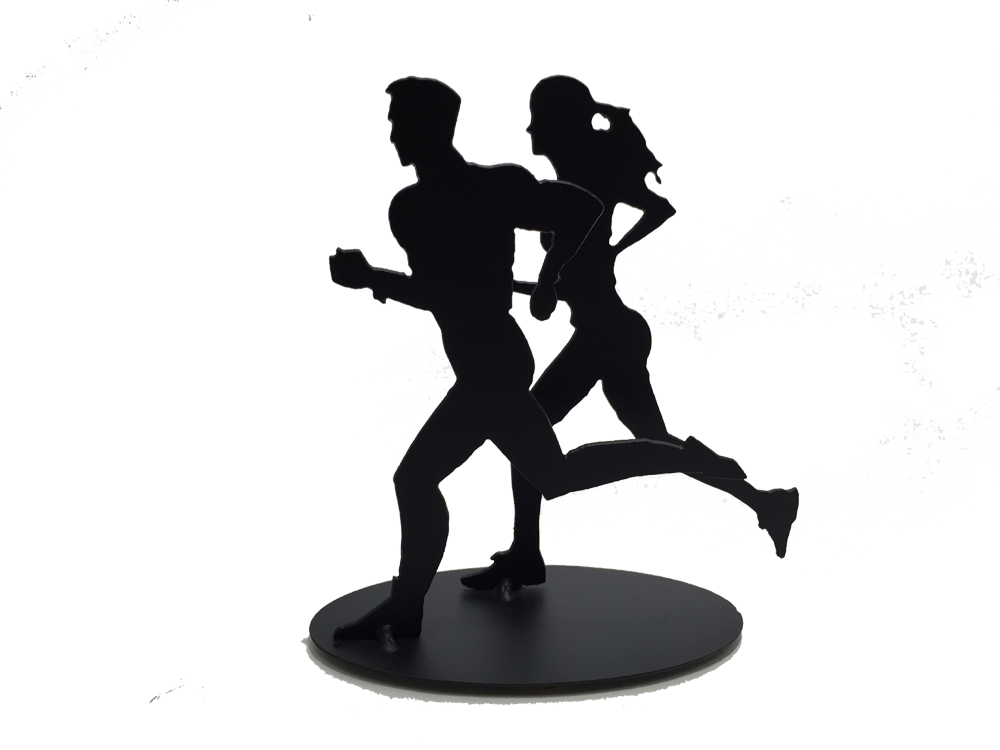 This metal sculpture shows the matte black silhouette of one male and one female figure running together. The female runner is slightly behind and to the right of the male. Both have one foot planted on the ground with the other in the air behind them. Both are pumping their arms as they run. The piece stands on a small oval base.